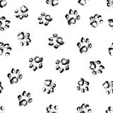Paw grunge footprint of dog or cat seamless pattern background. Vector stylish print animal feetprint illustration stylish print design Stock Photos