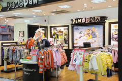 Paw in paw  baby clothes shop Stock Photo