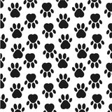 Paw print background. Footprint. Seamless background with footprint of dog, animal. Vector illustration. Paw print background. Footprint. Seamless background Stock Photos