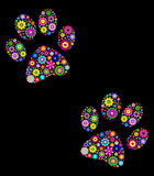 Paw print on black background. Vector illustration of  floral  animal paw print on black background Stock Photo
