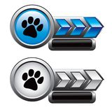 Paw print on blue and silver arrow nameplates Royalty Free Stock Images