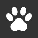 Paw print icon vector illustration isolated on black background. Stock Photography