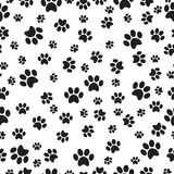 Paw print seamless pattern on a white background. Vector illustration.  Royalty Free Stock Images