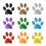 Paw Prints. Paws print  in different colors on a white background Royalty Free Stock Photo