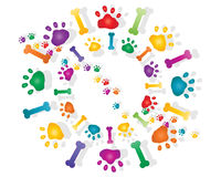 Paw prints. An illustration of colorful rainbow paw prints and bones with shadow in a circular design on a white background Royalty Free Stock Photography