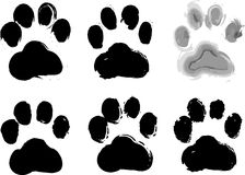 Paw prints. 6 different textured paw prints Royalty Free Stock Photos