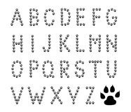 Paw prints alphabet - cdr format. Alphabet letters made from black paw prints on white background royalty free illustration