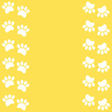 Paw prints animal on a yellow background stock photography