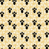 Paw prints on a beautiful background vector seamless pattern Stock Images
