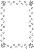 Paw prints border. Stock Images