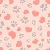 Paw prints and hearts seamless pattern royalty free stock image
