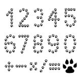 Paw prints numbers - cdr format. Numbers and mathematical signs made from black paw prints on white background Royalty Free Stock Photography