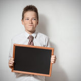 Pawky schoolboy with empty chalkboard Royalty Free Stock Photography