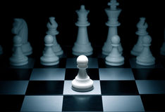 Pawn. Chess. White go the first. The central figure-pawn Royalty Free Stock Images