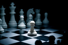 Pawn. Chess. White go the first. The central figure-pawn Stock Image