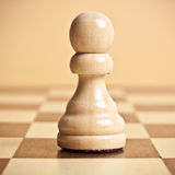 Pawn. On a chessboard close up Stock Photo