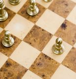 Pawn. Moved out on wooden chess board Stock Images