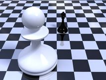 Pawn against queen on a chessboard. White pawn against black queen on a chessboard Stock Photo