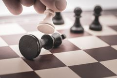 Pawn beats the king on a chess board. Concept how the pawn beats the king on a chess board royalty free stock images