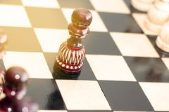 A pawn on a chess Board