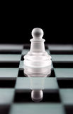 Pawn chess piece on chess board Stock Images