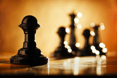 Pawn and chess pieces. Stock Photos