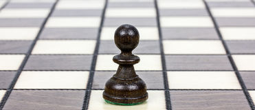 A pawn on a chessboard Stock Images