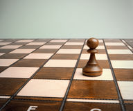 Pawn on chessboard Royalty Free Stock Images