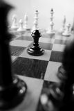 Pawn on a chessboard Stock Images