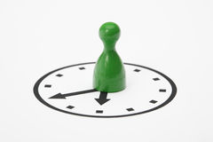 Pawn on a clock Stock Image