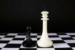 Pawn in front of enemy king. Unequal forces Stock Photo