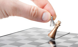 A pawn in the hand wins the King. Wins a pawn of the king. business concept Royalty Free Stock Images
