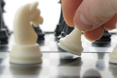Pawn in hands over a chessboard Royalty Free Stock Images