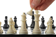 Pawn in hands over a chessboard. Selective focus Stock Photo
