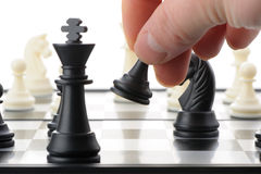 Pawn in hands over a chessboard Royalty Free Stock Image