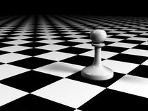 Pawn on a huge chessboard. White pawn on a huge chessboard Stock Photography