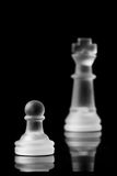 Pawn with King. Pawn in focus with king out of focus. Frosted glass chess pieces Stock Photo