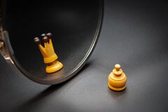 Free Pawn Looking In The Mirror And Seeing Himself Like A King With Dark Background Royalty Free Stock Images - 175860399