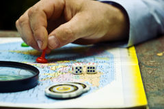 A pawn in a man`s hand on a geographical map of the world Royalty Free Stock Photography