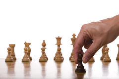 The pawn move. The pawn piece ready for it's move (selective focus Royalty Free Stock Photography