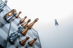 Pawn outside a chess-board. Royalty Free Stock Photos