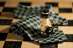 Pawn over necktie on chessboard. Pawn over checkered necktie on chessboard Stock Image