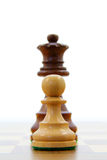 Pawn and queen Royalty Free Stock Photos