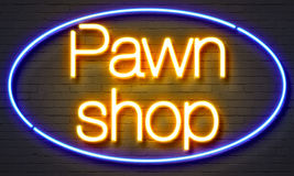 Pawn shop neon sign on brick wall background. Royalty Free Stock Images