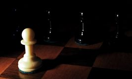 Pawn to dark. White pawn against darks pawns Stock Images