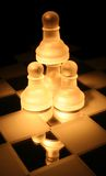 Pawn tower. Pawns stacked together stock images
