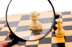 Pawn under magnifying glass Stock Photography