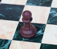 The pawn. Wooden chess piece Stock Photo