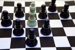 Pawns checkmate king Royalty Free Stock Image