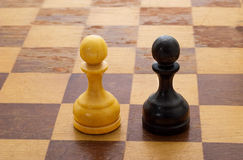 Pawns on a chessboard Royalty Free Stock Photography